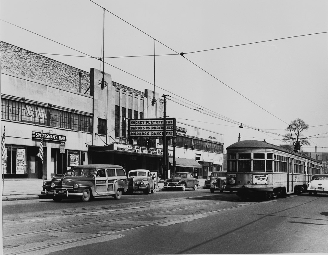 Outside the Cleveland Arena with streetcar on Euclid Avenue in Cleveland, OH before the Moondog Ball rock and roll concert, March, 1952