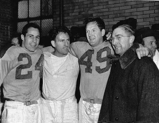 Cleveland Rams Jim Gillette, Bob Waterfield, Jim Benton, coach Adam Walsh after winning the NFL championship, Municipal Stadium, Cleveland, OH December, 1945